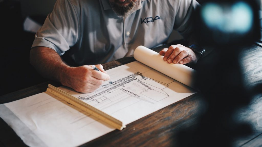 Man looking at house drawings
