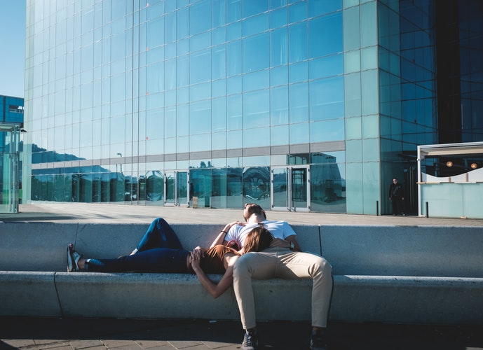 man and woman relaxing in city